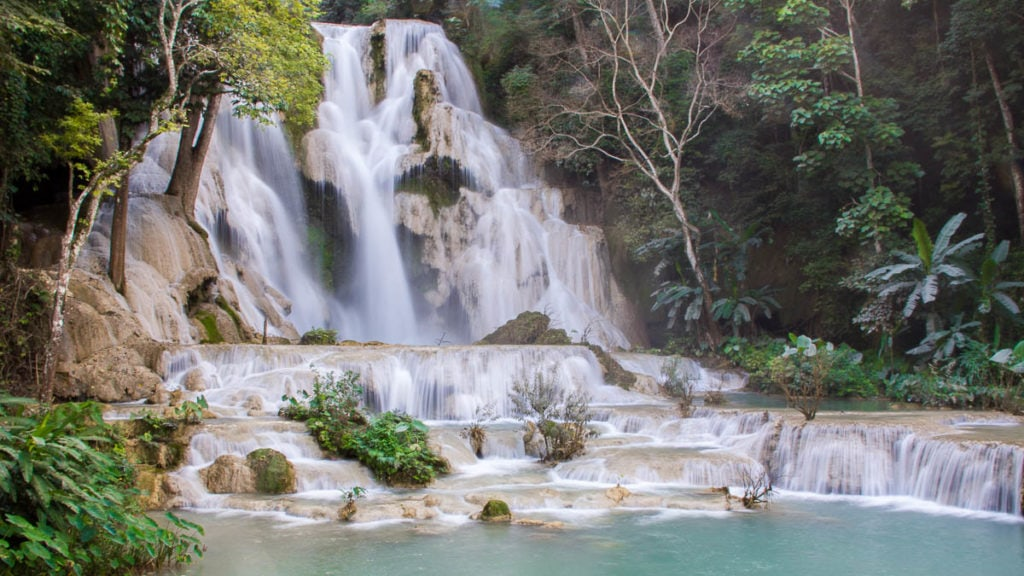 The three-tier stone surface is home to one of the biggest natural waterfalls in Luang Prabang, Laos.