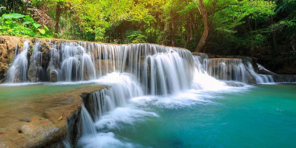 Erawan Falls is truly enchanting. Known as one of Thailand's most beautiful waterfalls, the emerald waters of Erawan Falls are enticing.